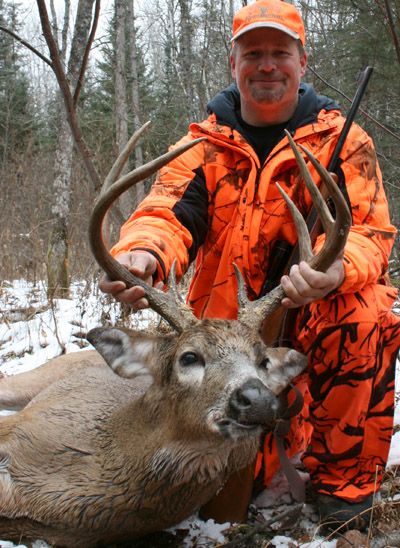 Dr Ken Nordberg's son Ken with a trophy-class 8-pointer from 2012